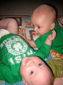 Twins playing together on St. Patty's Day.