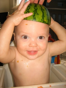 Hudson showing off his new watermelon hat
