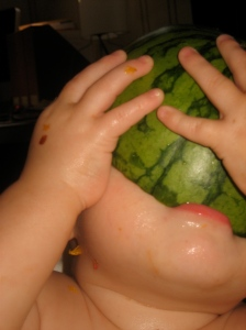 Hudson chomping down on watermelon