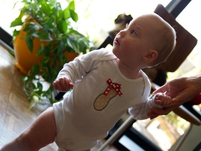 Ellisa in her girl peanut onesie
