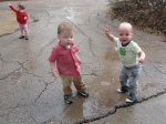 Max and Hudson Splashing in a Rain Puddle (Vivi in the corner)