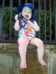 Ellisa Sitting on the Edge of the Pool