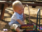 Hudson Putting Rocks in His Easter Basket