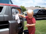 Hudson Cleaning Mommy's Car